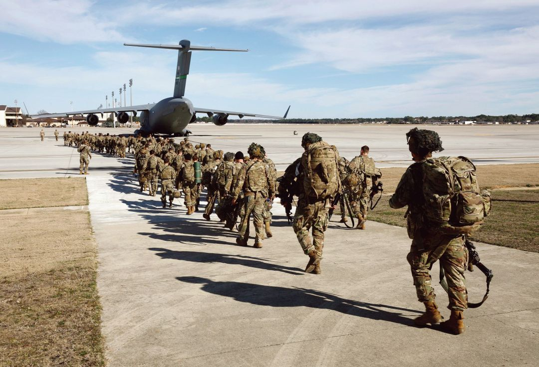 U.S. Army paratroopers of an immediate reaction force from the 82nd Airborne Division leave Fort Bragg